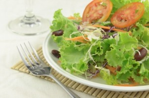 plated leafy salad with kidney beans and fork ID-10047899